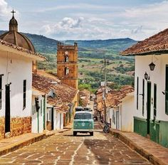 One of the coolest little towns you'll find in Colombia. Even better when you're able explore it in a 'bitchin VW bus 🚌 Places To Travel, Travel Destinations, Places To Visit, Ely, Vw Bus, Vw Camper, Stone Street, Colombia Travel, Camping Humor