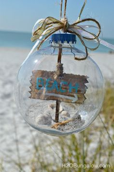 DIY beach themed Christmas tree ornament filled with sand, shells, driftwood and starfish http://www.H2OBungalow.com