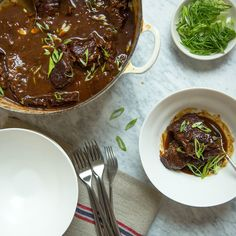 These best-ever short ribs get meltingly tender in a sauce made with sherry, cherries, mirin, miso and soy sauce. Get the recipe at Food & Wine.
