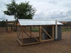 Chicken Coop Tractor. I like the roof and the feeding tube on the side which might work good in the flight pen.