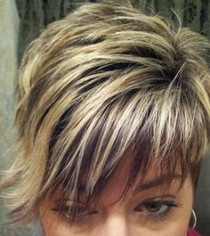 Asymmetrical short hair with peek-a-boo low-lights coming through blond highlights.