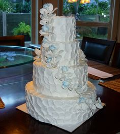 Textured buttercream with Blue Sugar Orchids