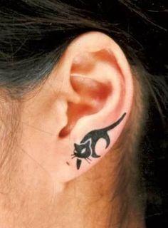 Prowling cat tattoo earlobe