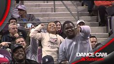 The Dancing Usher and an excited young fan have an impromptu dance-off when the Pistons played the Knicks at home Nov. 19, 2013. / via @xuhulk
