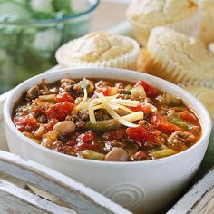 This warm and comforting chili offers a mix of beef and pork. Pinto beans, canned tomatoes, and green sweet peppers keep the recipe classic./