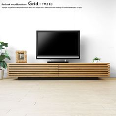 joystyle-interior: Cool TV board low board which is correct in lattice door wooden TV stand modern living of 2 size walnuts materials walnut pure materials of in width in width Tv Stand Decor, Tv Decor, Wall Decor, Living Room Tv, Apartment Living, Apartment Interior, Low Tv Stand, Barn Door Tv Stand, Barn Doors