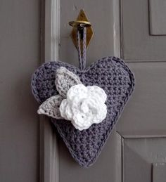 """soaring-imagination: """" Crochet heart hanging and rosette by Ingrid of Studio 92 Designs. {Love the use of the grey and white…subtle and a bit vintage I think! Crochet Vintage, Crochet Diy, Crochet Home, Love Crochet, Crochet Gifts, Crochet Motif, Beautiful Crochet, Crochet Flowers, Crochet Patterns"""