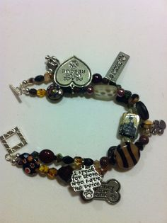 Animal Rescue Bracelet - double stranded - beads from around the world, donation made to animal rescue, shelter  $45.00 https://www.etsy.com/listing/109570819/animal-rescue-double-strand-beaded