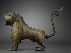 This lion, which served as a fountain spout, was found at Monzón de Campos (Palencia, Spain). Epigraphic analysis has dated it to the 12th–13th century. It is one of the few metal artifacts of the Islamic west to have survived from this period.