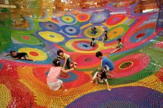 """Japanese artist Toshiko Horiuchi-MacAdam is considered one of Japan's leading fiber artists, using knitting and crochet as the foundation for much of her work. Her website explains that she specializes in """"creating large, interactive textile environments that function both as imaginative and vibrant explorations of color and form, at the same time as providing thrilling play environments."""""""