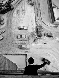 This illusion of a man playing with cars was shot from the top of the building. The space, size, interposition, and illusionary perspective of the subjects in the picture enables the photographer to manipulate depth perception.