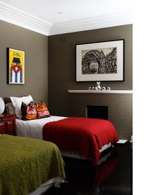ooo, dark grey walls with bright green and red bedspreads