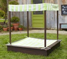 DIY Sandbox Tutorial. I like the canopy, great way to keep the sun off the kids when you don't have shade in the yard.