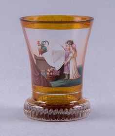 """Attributed to Anton Kothgasser (1769-1851)Vienna, circa 1820, height: 11 cmColourless glass, partly stained yellow, gold and colour painting: """"An Fertile"""" (a fertile year), 16-pointed yellow stained star to base."""
