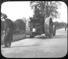 Cubbington. Traction engine Traction engine pulling up hedges in the Coventry Road, Cubbington. 1920s