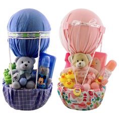 Baby Air Balloon Gift Basket This gift basket idea is the perfect gift for the expecting mother or newborn child. This cute gift basket highlights a hot air balloon theme and comes stocked with everything you need for a newborn baby. Saw this on overstock.com website. Baby blankets are used as the wrapper.