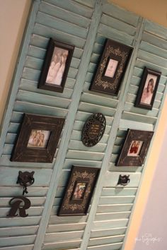 I have some of these doors!  Old shutters to display pictures. Tuck the frame easel between the slats.