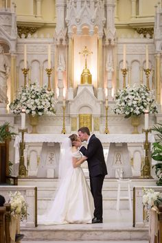 Bride and Groom First Kiss at Wedding Altar.