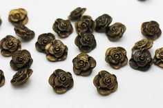 10 pieces of Antique Bronze Rose Shank Buttons  ♥ MEASUREMENT  1.6cm * 1.6cm  ♥ QUANTITY  10 pieces ♥ PACKAGING  These buttons are well-packed in a transparent plastic bag.  ♥ MATERIAL  ABS (not metal)    All the items are shipped from Hong Kong with the well-reputed Hong Kong Post. Every item will be shipped WITHOUT tracking to minimize your shipping cost!  If you have any question or would like more pictures, please do not hesitate to let me know