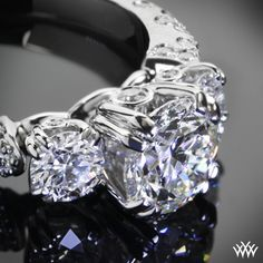 "Inspired by Champagne bubbles. Beautifully unique, the ""Petite Champagne"" 3 Stone Engagement Ring is sure to stop traffic! Beaming with 44 A CUT ABOVE® Hearts and Arrows Diamond Melee---- if I Marry myself I'm buying myself this ur square..."