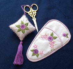 The Scissor Case was completely stitched in the hoop. Scissor Fob was embroidered in two and sewing them using your straight stitch sewing machine, you can also stitch the as a Biscornu as well if you want.