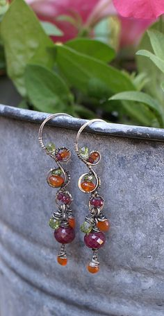 Loops of grace  Large beautiful rubies with orange carnelian, facets of peridot and sterling silver. If you are lucky these might still be available at Willows in Chelan WA. A great little boutique.