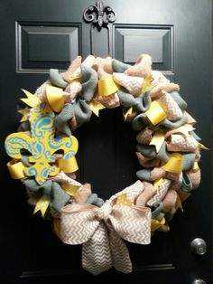Front door wreath. Blue and yellow with burlap and paint stencil on wooden fleur de lis