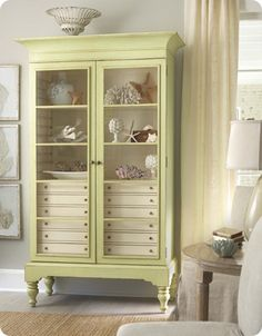 Not crazy about the sea shells, but love the piece. Especially the drawers inside.