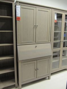 IKEA Hemnes secretary and shelving units.  @Anna Totten Lynch -- This would be a great set-up for your desk wall!  Lots of storage space, and the laptop desk folds out, but is otherwise concealed.