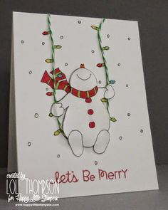 Swinging on a string of lights - who wouldn't be smiling?  The happy snowman is a digital stamp, with lots of shimmer and shiny colored lights.  DIY Christmas card