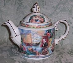 James Sadler, famous maker of teapots introduced this teapot in 2003.  Sure to become a collectible, it depicts scenes related to the history of tea.  It is beautifully trimmed in gold and is from the