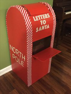 "Cardboard ""Letters to Santa"" Mailbox (Materials used: cardboard boxes, contact paper and candy cane ribbon)"