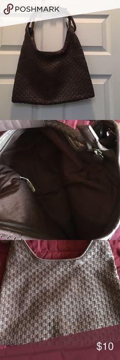 "Shoulder bag. Woven (not leather), but looks it. Never used. Shoulder strap not adjustable. Measures 12""x12"". Inside has one zip pocket. No other pockets. Very soft. GAP Bags Shoulder Bags"