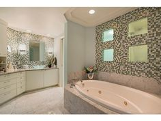 Large master bathroom with soaking tub - intricate tile work - mosaic - marble - vessel sinks | Pelican Isle | North Naples, Florida
