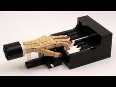This is a custom designed kinetic sculpture of a hand playing a piano. Both the hand and the piano are built entirely using LEGO parts. Photos of this model . Lego Engineering, Lego Sculptures, Amazing Lego Creations, Piano Bar, Piano Player, Digital Piano, Lego Parts, Brickwork, Cool Lego