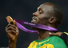 Usain Bolt admires his second gold medal of London 2012, after winning the 200m final