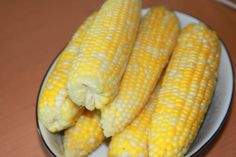 Milk Boiled Corn on the Cob  6-8 ears corn, husks and silk removed  water  1 1/4 cup milk  1/3 cup brown sugar  1/4 cup butter (optional and to add to the water)