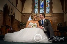bride and groom sitting in the church. New Zealand wedding photography http://www.paulmichaels.co.nz/ PaulMichaels Wellington photographers.