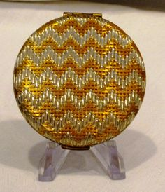 A vintage Estee Lauder 1960 Golden Weave powder compact in excellent condition.