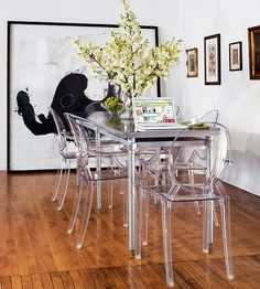 Big Impact in a Small Space. Ghost chairs and a narrow table create big dining in a tiny space. Love the splash of BIG fun art.