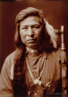 Tah It Way, Native American of the Calumet Tribe, photograhed by Edward Curtis in 1905. Tah It Way, head-and-shoulders portrait, facing front, peace pipe on right.