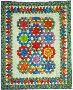 """Byzantine Flower Garden - The Creative Pattern Book, 1999. Designed and pieced by Judy Martin. Quilted by Jean Nolte. 50"""" x 61"""". An alternate colorway is also presented in a larger size."""