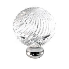 The M30S Crystal Cabinet & Drawer Knob Series from Cal Crystal features a globe design, is medium in size with an engraved swirl pattern for added play with light. A crystal knob with 8 stem finishes to choose from.