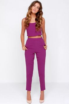 "With the Together Forever Purple Two-Piece Set, you'll never have to worry about a mismatched outfit ever again! A cute sleeveless crop top has a scoop neck and darted bodice, while the high-waisted pants have subtle pleats, tapered legs, and two front pockets. Exposed back zipper on top; hidden side zipper/clasp on pants. Top is lined; pants are not. Small top measures 15.5"" long. Small bottoms measure 37.5"" long. 100% Polyester. Hand Wash Cold. Imported."