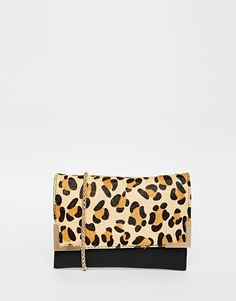 $57, Street Level Leopard Clutch Bag. Sold by Asos. Click for more info: https://lookastic.com/women/shop_items/349197/redirect