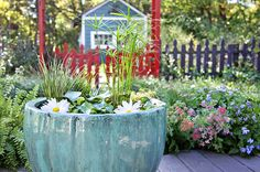 Create a calming oasis on your patio with an easy, mini pond. You don't even need fancy pumps—just water.