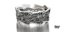 Wave band in sterling silver. $250.00, via Etsy.