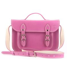 Electric Rose        11inch(29cm) - Rock this glossy vibrant pink sweet small 11 inch leather satchel. It has clever magnetic clasps that allow you to get access to all your pretty things quickly. However - buckles are still a part of the look of the bag to keep its authentic vintage style! This sweet bag is a top seller because of it's great colour. The Electric Rose small satchel also comes with a built in shoulder strap that's top stitched so it won't stretch like others out there…