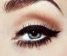 Thick black eye liner + white eye liner on waterline. Nice contrast.