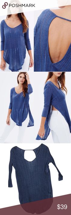 NWT Free People Astoria Hacci Spliced Ribbed Top 🎁Offers welcome                                                                                🔑Bundle to save                                                                                                   👍Like for price drop notifications                                   NWT never worn. Denim soft Vneck, 3/4 length pullover sleeve, open round V back with shoulder strap, rounded high low hem with high side vents, easy-care soft…